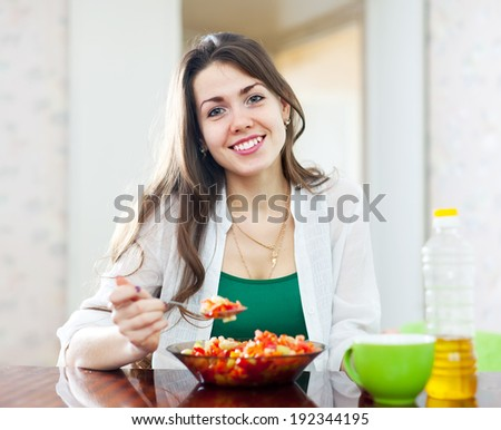 beautiful healthy girl eating vegetarian lunch at home - stock photo