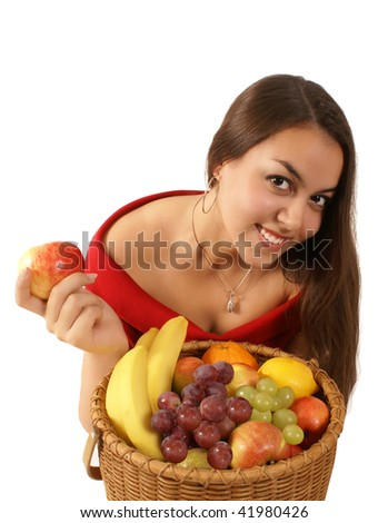 Beautiful healthy girl with basket of fruits