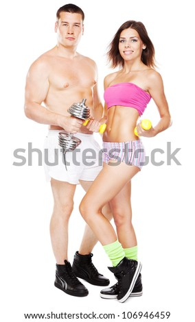 Beautiful healthy-looking young couple in sports outfit - stock photo