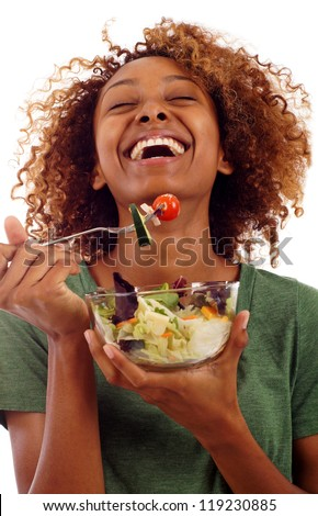 Beautiful healthy mixed Black Hispanic / Latin woman eating a fresh healthy salad isolated over white background - stock photo