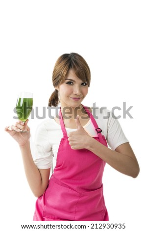 Beautiful healthy smiling woman holding and about to drink an organic green smoothie. Isolated on white.  - stock photo