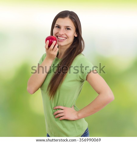 Beautiful Healthy Smiling Young Woman, eating organic red apple - stock photo