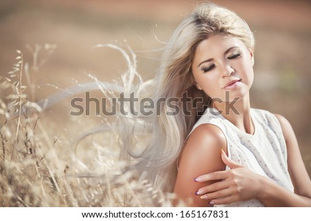 Beautiful healthy woman outdoors, aromatherapy, perfect skin, heath care. Portrait of young happy woman on nature in wheat field.