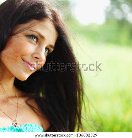 Beautiful Healthy Woman over Nature background - stock photo