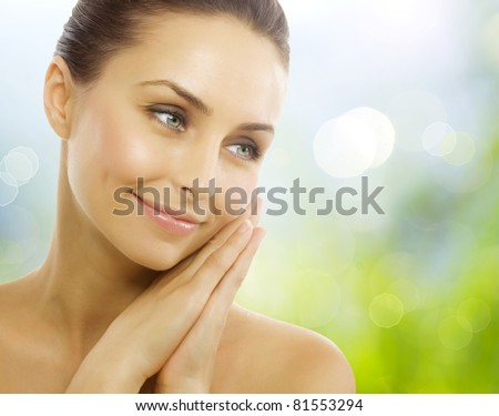 Beautiful Healthy Woman over Nature background.Perfect Healthy skin - stock photo