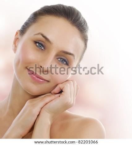 Beautiful Healthy Woman touching her skin - stock photo