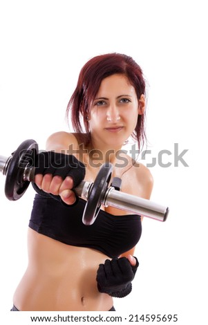 Beautiful healthy young girl with a dumbbell on a white background.