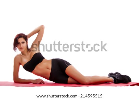 Beautiful healthy young girl with gym clothes on a white background.
