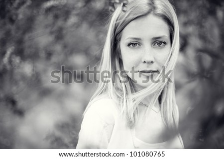 Beautiful healthy young woman with spring flowers