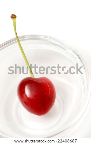 beautiful heart shaped cherry isolated over a white background