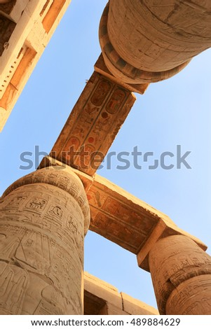 Beautiful heiroglyphs with original bright colors in  the most important Pharaonic site with   giant pillars from  Ancient Egypt at Karnak Temple, Luxor