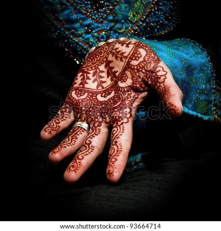 Beautiful henna tattoo in a bride's hand 05 - body art - stock photo