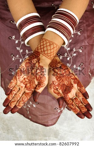 Beautiful henna tattoo on bride's hand - stock photo