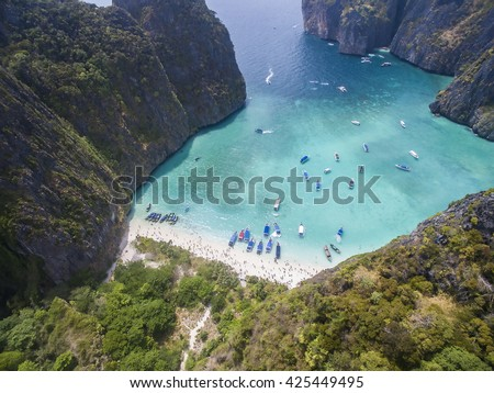 Beautiful hidden bay with white sands and clear blue water in tropical island. Maya Bay, Phi Phi Islands, Phi Phi Lei Island, Thailand - stock photo