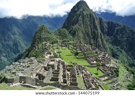 Beautiful hidden city Machu Picchu in Peru - stock photo