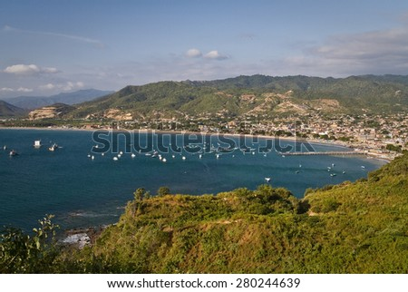 Beautiful high angle view during sunset of Puerto Lopez, popular vacation spot in the Ecuadorian coast - stock photo
