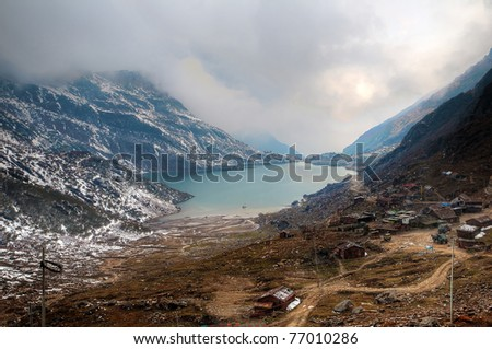 Beautiful high dynamic range image of Changu lake in Sikkim and the surrounding vista - stock photo