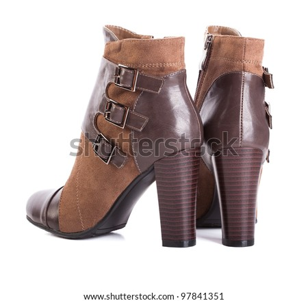 Beautiful high heels shoe in brown leather. - stock photo