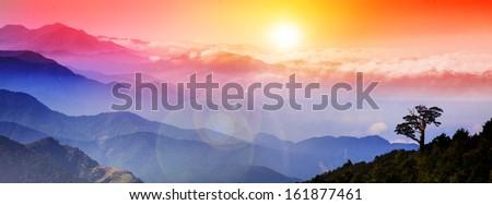 Beautiful high mountain sunrise - stock photo
