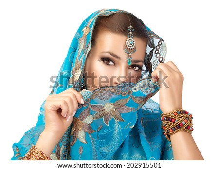 Beautiful hindu woman with traditional clothes, jewelry and makeup - stock photo
