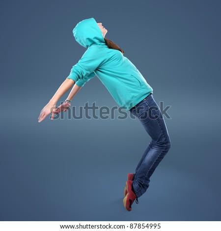 Beautiful hip-hop style female dancer in studio - stock photo
