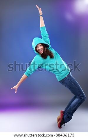 Beautiful hip-hop style female dancer on scene - stock photo