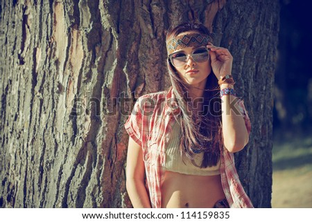 Beautiful hippie girl near tree - stock photo