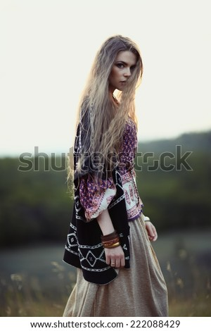 Beautiful hippie girl on nature of evening. Boho fashion style - stock photo