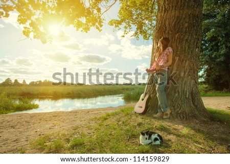 Beautiful hippie girl with guitar - stock photo