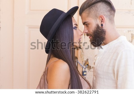 Beautiful hipster couple loving each other deeply and truely. - stock photo