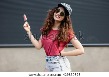 Beautiful hipster girl eating a delicious ice cream - stock photo