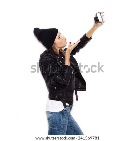 Beautiful hipster girl making selfie. Emotion. Toned.  White background, not isolated