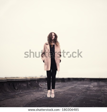 beautiful hipster girl on the roof - stock photo