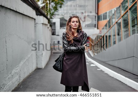 Beautiful hipster girl walking in the street