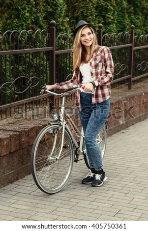 beautiful hipster girl with bike