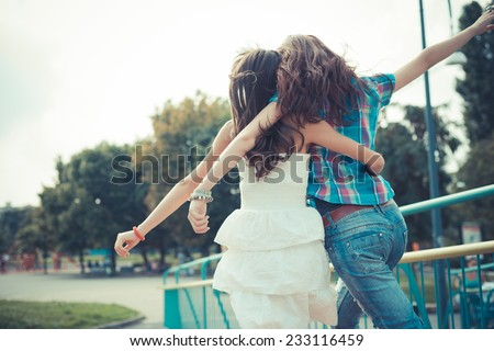 beautiful hipster young women sisters friends in the city - stock photo