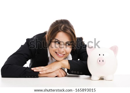 Beautiful hispanic business woman holding a piggy bank, isolated over white background