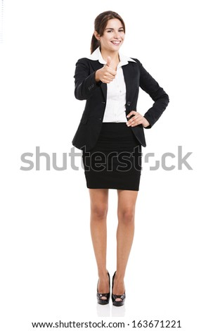Beautiful hispanic business woman smiling with thumbs up, over a white background - stock photo