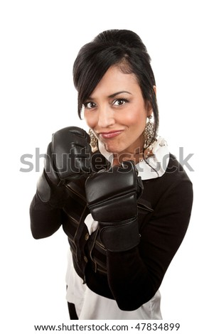 Beautiful Hispanic businesswoman smiling with boxing gloves