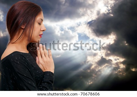 Beautiful Hispanic Latino Christian woman in deep prayer - stock photo