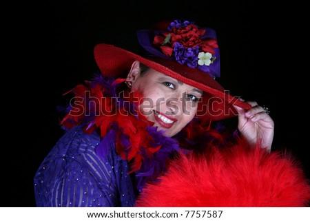 Beautiful hispanic woman isolated on black background - stock photo