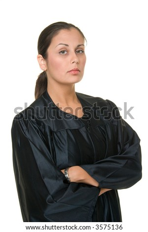 Beautiful Hispanic woman judge in black judicial robes standing with her arms crossed. - stock photo
