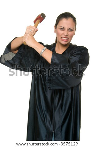 Beautiful Hispanic woman judge in black judicial robes with a threatening grimace holds a real sledge hammer ready to administer justice. - stock photo