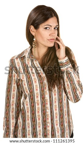 Beautiful Hispanic woman with hand near face on isolated background - stock photo