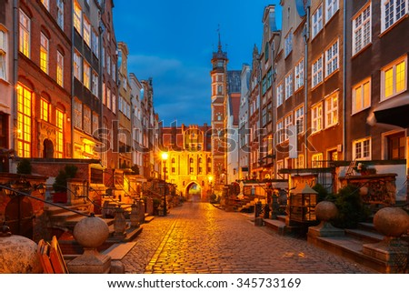 Beautiful historic houses on Mariacka, St Mary, street and gate in Gdansk Old Town, Poland - stock photo