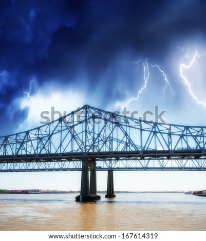 Beautiful historical Crescent City Connection Bridge in New Orleans Louisiana. View during a storm. - stock photo