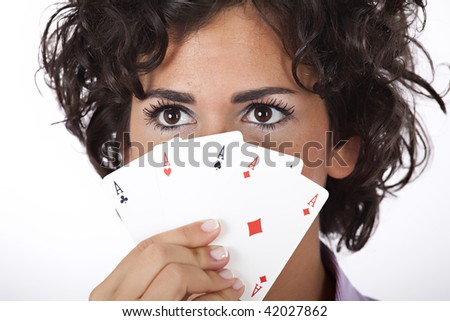 Beautiful holding playing cards with all four aces - stock photo