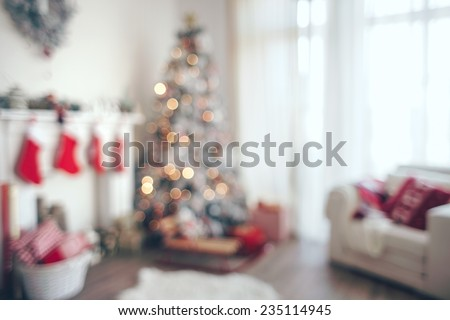 Beautiful holiday decorated room with Christmas tree, out of focus shot for photo background - stock photo