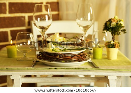 Beautiful holiday Easter table setting in green tones, on bright background