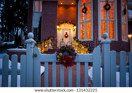 Beautiful holiday entrance decorated and lighted for Christmas